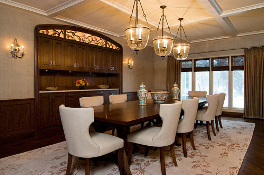 Formal dining room with dark wood finishes.